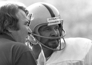 Oakland Raiders quarterback Ken Stabler (12) talks with Hall of Fame head coach John Madden during the Raiders 20-14 loss to the Los Angeles Rams on December 4, 1977 at the Los Angeles Memorial Coliseum in Los Angeles, California.  (AP Photo/NFL Photos)